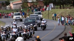 The funeral procession carrying the remains of former South African President Nelson Mandela proceeds to Mandela's hometown and burial site in Qunu, Dec. 14, 2013.