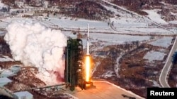 A video grab from KCNA shows the Unha-3 (Milky Way 3) rocket launching at North Korea's West Sea Satellite Launch Site, at the satellite control center in Cholsan county, North Pyongang province, Dec. 13, 2012.