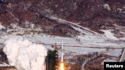 A video grab from KCNA shows the Unha-3 (Milky Way 3) rocket launching at North Korea's West Sea Satellite Launch Site, at the satellite control center in Cholsan county, North Pyongan province, Dec. 13, 2012.