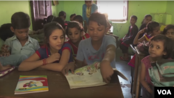 Indian students taking classes at an education center