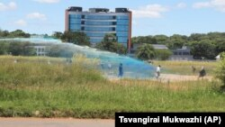FILE: A Zimbabwean police water cannon disperses war veterans who had gathered to demonstrate against a faction within the ruling Zanu pf party reportedly led by the First Lady Grace Mugabe in Harare, Thursday, Feb. 18, 2016. (AP Photo/Tsvangirayi Mukwazhi)