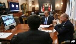 Turkey's President Recep Tayyip Erdogan, right, gestures as he speaks to Venezuela's President Nicolas Maduro during a conference call, in Ankara, Turkey, May 17, 2018.