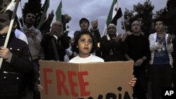 支持叙利亚反对派的海外叙利亚人10月15日在雅典举行抗议示威