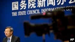 中国商务部副部长王受文2018年6月28日参加新闻发布会,就最新发表的《中国与世界贸易组织》白皮书介绍情况(美联社)