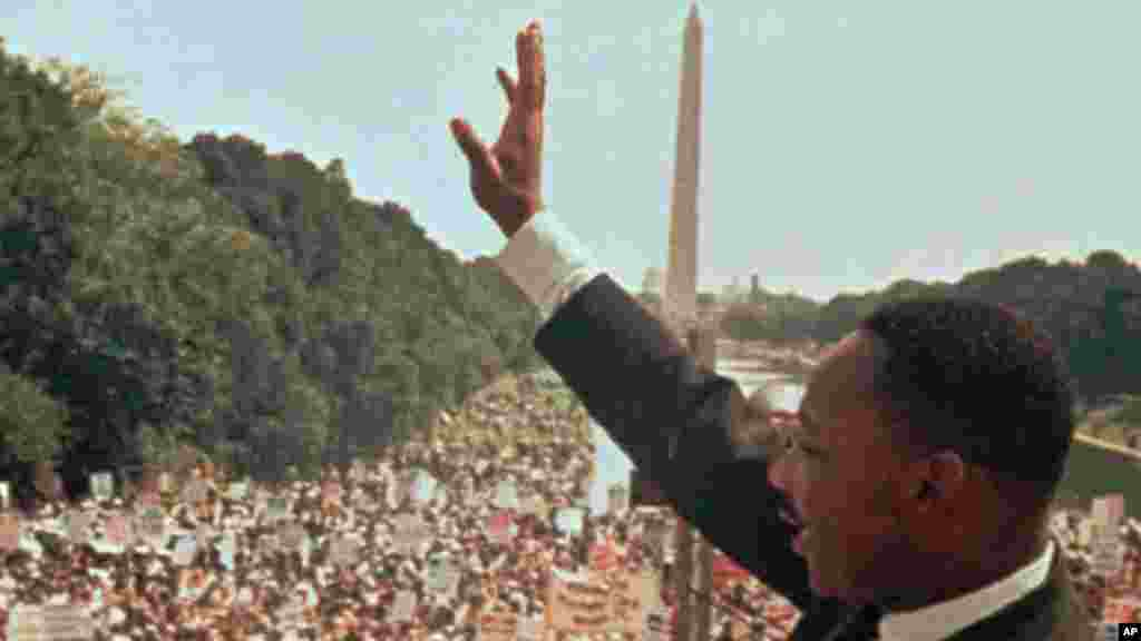 """Dr. Martin Luther King Jr. acknowledges the crowd at the Lincoln Memorial for his """"I Have a Dream"""" speech during the March on Washington, D.C. in this Aug. 28, 1963 file photo."""