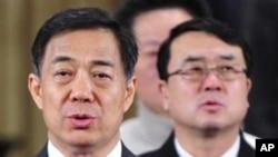 重庆前中共市委书记薄熙来(左)和重庆前副市长王立军(右)(资料照)