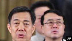 中共重庆前市委书记薄熙来(左)和重庆前副市长王立军(右)(资料照)