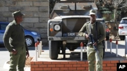FILE - Army personnel are seen outside the military headquarters in Maseru, Lesotho.