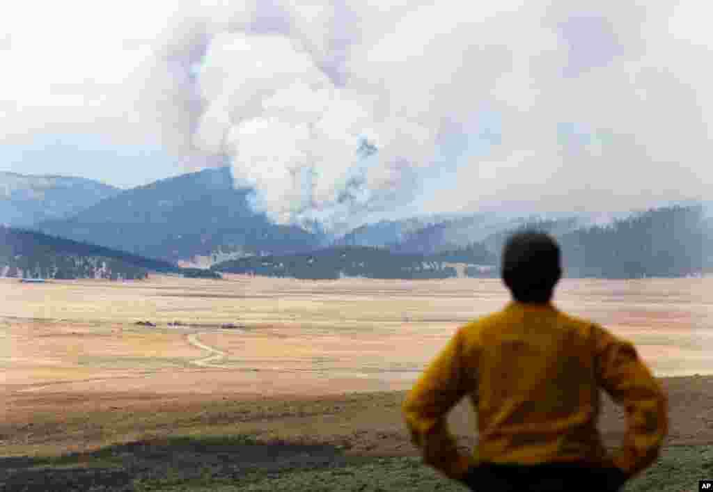 June 30: Smoke rises from the Las Conchas fire near Los Alamos, N.M. (AP Photo/Jae C. Hong)
