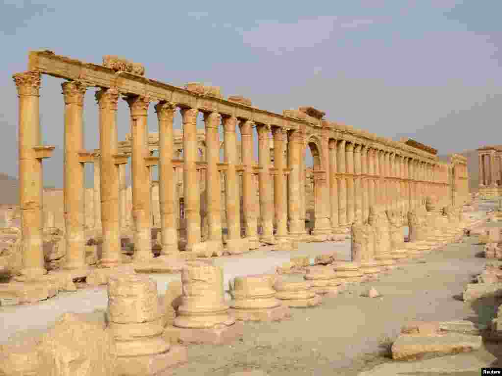 The demolition of ancient monuments like this colonnade in the historical city of Palmyra, Syria was targeted by the Islamic State group and among cultural sites destroyed in 2015.