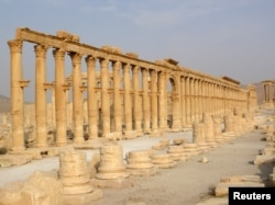 FILE - This colonnade in the historical city of Palmyra, Syria, was among cultural sites destroyed by the Islamic State group in 2015.