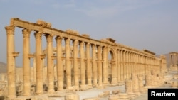 FILE - The demolition of ancient monuments like this colonnade in the historical city of Palmyra, Syria was targeted by the Islamic State group and among cultural sites destroyed in 2015.