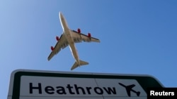 FILE - An aircraft takes off from Heathrow airport in west London.