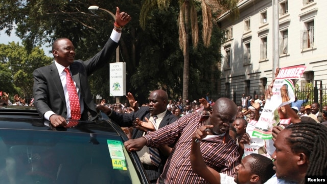 Kenya's Deputy Prime Minister Uhuru Kenyatta leaves in company of supporters after he was cleared by the  Independent Electoral and Boundaries Commission to run for the presidency in the March 4 presidential elections in capital Nairobi, January 30, 2013.