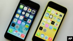 The iPhone 5S, left, and iPhone 5c, Sept. 17, 2013.