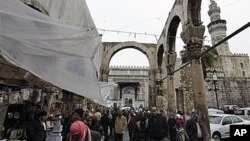 """Worshipers leave the Omayyad Mosque in old Damascus, Syria. Campaigns on Facebook and Twitter have called for a """"day of rage"""" in Damascus on Friday and Saturday, February 4, 2011"""