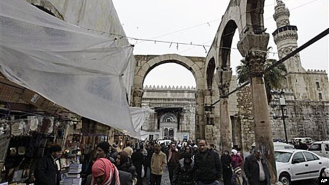 "Worshipers leave the Omayyad Mosque in old Damascus, Syria. Campaigns on Facebook and Twitter have called for a ""day of rage"" in Damascus on Friday and Saturday, February 4, 2011"