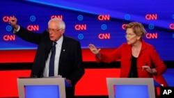 버니샌더스 상원의원(왼쪽)과 엘리자베스 워런 상원의원이 30일 CNN이 주관한 토론에서 발언하고 있다.