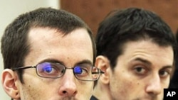 US hikers Shane Bauer, left, and Josh Fattal, attend their trail at the Tehran Revolutionary Court, Iran, February 6, 2011