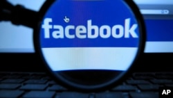 FILE - Facebook security officials say they found fake account had bought advertising for divisive social issues. The company said the accounts were likely based in Russia. (AP Photo/dapd, Joerg Koch)