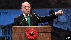 """Turkey's President Recep Tayyip Erdogan addresses health sector workers in Ankara, Turkey, March 14, 2017. Angered by recent moves by Germany and the Netherlands to restrict rallies in his support by Turkish emigres, Erdogan said Wednesday that a """"Turkophobia"""" in running rampant in Europe."""
