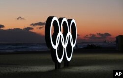 Olympic rings are placed at the beach before sunrise in Gangneung, South Korea, Jan. 24, 2018. Gangneung is the site of the coastal cluster which will host ice hockey, figure skating, speedskating, short track and curling for the 2018 Olympics from Feb.