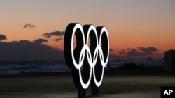 FILE - Olympic rings are placed on the beach before sunrise in Gangneung, South Korea, Jan. 24, 2018. Gangneung is the site of the coastal cluster which will host ice hockey, figure skating, speedskating, short track and curling for the 2018 Olympics from Feb. 9 to 25.