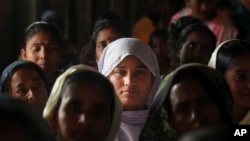 FILE - Migrant Muslim women are seen at a health mission in Baralakhaiti village, about 70 kilometers (43 miles) north of Gauhati, Assam State, India, Feb. 10, 2014.