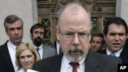 FILE - John Durham speaks to reporters on the steps of U.S. District Court in New Haven, Conn., April 25, 2006.