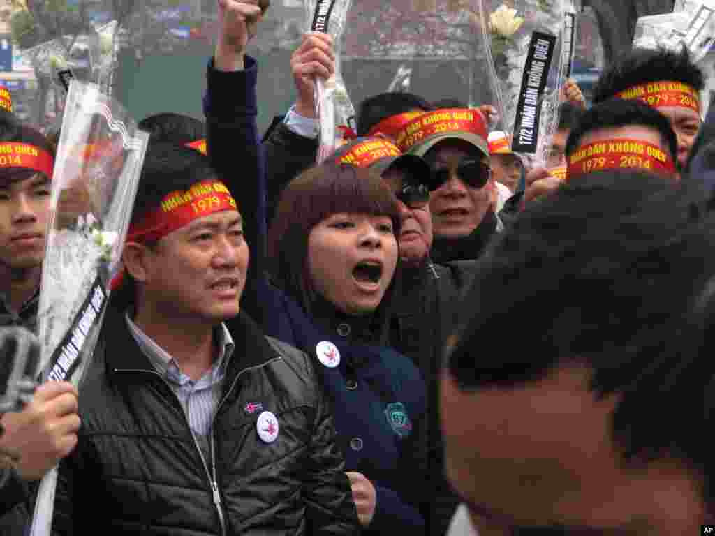 Anti-China protestors rally in the Vietnamese capital Sunday, Feb. 16, 2014 to mark the 35th anniversary of a border war between Vietnam and China.