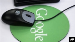 In this Oct. 2006 file photo, a mouse sits atop a Google mouse pad at Google's New York office.