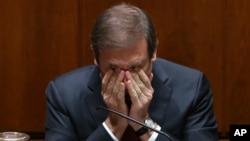 Portuguese Prime Minister Pedro Passos Coelho rubs his eyes during the debate of the government's four-year policy program at the Parliament in Lisbon, Nov. 10, 2015.