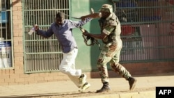 FILE: A Zimbabwean soldier beats a man in a street of Harare on August 1, 2018 as protests erupted over alleged fraud in the country's election. (AFP)