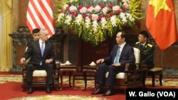 U.S. Defense Secretary Jim Mattis chats with Vietnamese President Tran Dai Quang at the presidential palace in Hanoi, Vietnam, Jan. 25, 2018.