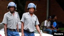 Zimbabwean police patrol the streets of the capital Harare, March 1, 2011.