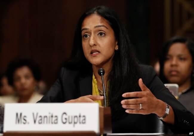FILE - Vanita Gupta, incoming president and CEO of The Leadership Conference for Civil and Human Rights, testifies on Capitol Hill in Washington, May 2, 2017, before a Senate Judiciary Committee hearing on responses to the increase in religious hate crimes.