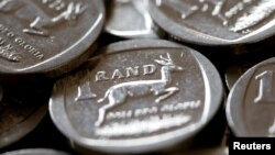 South Africa's rand plunges more than 10 percent to a 2-year low against the dollar, Aug. 13, 2018.