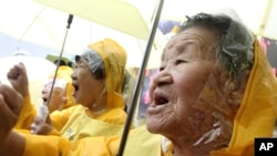 "FILE - Former ""comfort women"" who served the Japanese Army as sexual slaves during World War II, at a rally before Korean Liberation Day."