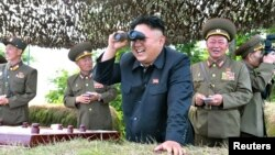 North Korean leader Kim Jong Un at a military inspection in this undated photo released by North Korea.