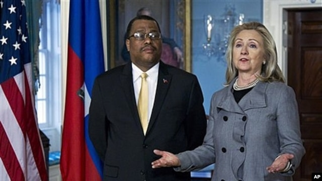 Secretary of State Clinton with Haitian Prime Minister Garry Conille in Washington, Feb. 8, 2012.