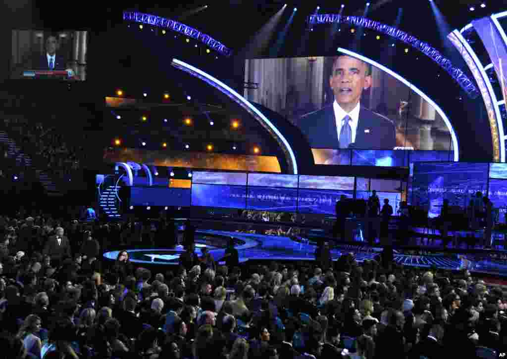 President Barack Obama appears on screen at the 15th annual Latin Grammy Awards at the MGM Grand Garden Arena, in Las Vegas, Nov. 20, 2014.