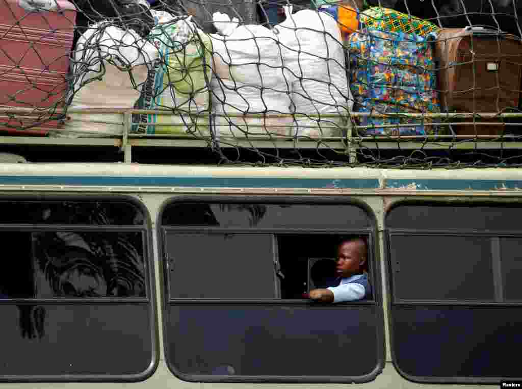 A child sits inside a bus heading to a boarding school for the opening day of the new school term, in Mbare township, Harare, Zimbabwe.