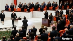 Turkey's new President Tayyip Erdogan attends a swearing in ceremony at the parliament in Ankara, Aug. 28, 2014.