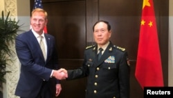 美国代理国防部长沙纳汉同中国国防部长魏凤和2019年5月31日在新加坡的一个亚洲安全峰会上举行会谈。