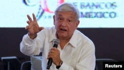 FILE - Leftist front-runner Andres Manuel Lopez Obrador, presidential candidate of the National Regeneration Movement (MORENA), addresses the audience during the Mexican Banking Association's annual convention in Acapulco, Mexico, March 9, 2018.