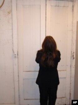 Rebecca Maitland opens doors leading to the underground gold vault.