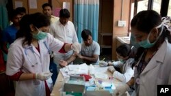 A patient has his blood taken to be tested at a fever clinic especially set up to cater to those suffering from fever, one of the main symptoms of several mosquito-borne diseases such as dengue, at a hospital in New Delhi, India, Sept. 15, 2016. The World