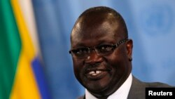 Backers of South Sudan's ex-Vice President Riek Machar, shown here speaking to reporters at the U.N. in July, say they are ready to meet with President Salva Kiir in Addis Ababa -- but insist that one condition be met.