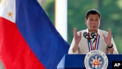 FILE - Philippine President Rodrigo Duterte gestures while speaking following a wreath-laying ceremony in observance of National Heroes Day, Aug. 29, 2016 at the Heroes Cemetery in suburban Taguig city, east of Manila.