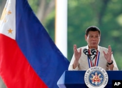 FILE - Philippine President Rodrigo Duterte speaks in suburban Taguig city, east of Manila, Aug. 29, 2016.